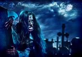 Undead zombie scary girl on halloween graveyard at night on dark clouds sky background. Woman in zom poster