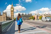 London city urban lifestyle tourist woman walking. Businesswoman commuting going to work on Westmins poster