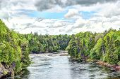 Montmorency River In Boischatel Town, City Of Quebec Landscape During Cloudy, Overcast Day With Pine poster