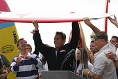 HUNTINGTON BEACH, CA - OCT 6: Arnold Schwarzeneggerwas presented with a surfboard at the CA Comeback Express Bus Tour in Huntington Beach, CA on October 6, 2003.