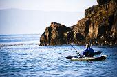 Fisherman Paddling