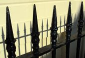 Spiked Railings And Shadows