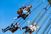 picture of carnival ride  - Teenage girls on the chain swing carousel - JPG