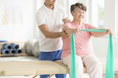 Elderly Woman Doing Exercises poster