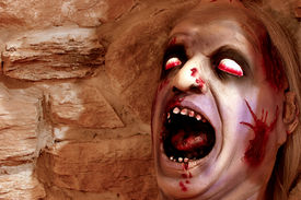 image of scary face  - Scary deformed head for Halloween against a stone wall - JPG