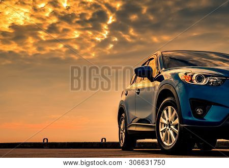 poster of Blue Compact Suv Car With Sport And Modern Design Parked On Concrete Road By The Sea With Beautiful