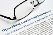 Close up of glasses on Operating Costs And Revenues