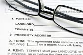 Close up of glasses on Rental Agreement