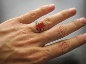 Yemeni Red Aqeeq Agate Stone. Male Hand With Ring On Ring Finger With Dark Background. Yemen Ring. M poster