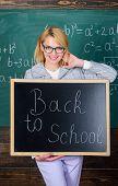 Teacher Woman Hold Blackboard Inscription Back To School. It Is School Time Again. School Teacher Gl poster