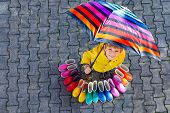 Little Kid Boy And Group Of Colorful Rain Boots. Blond Child Standing Under Umbrella. Close-up Of Sc poster