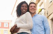 Happy Carefree Multi-ethnic Couple Embracing And Looking Into Distance. Smiling Beautiful Young Love poster