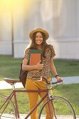 Young Female Student With Backpack And Books Riding A Retro Bicycle.female On Retro Bicycle. Young F poster
