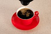 Red Cup Being Filled With Black Coffee