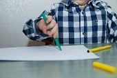 The Boy Draws Felt-tip Pens On Paper. Drawing. Little Boy. Childrens Drawing. Developmental Activiti poster