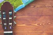Wooden Background With A Fingerboard From The Guitar, Music Flatlay Frame Top View Close-up poster