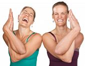pic of namaskar  - Two laughing women performing entwined namaskar over white background - JPG