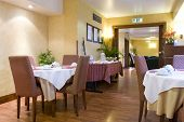 Elegant decorated dining room (Empty restaurant with set tables)