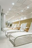 Sunbeds in the fitness (spa) near the ocean - Relax concept