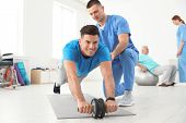 Professional Physiotherapist Working With Male Patient In Rehabilitation Center poster