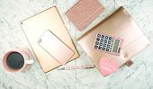 Feminine Desk Workspace With Rose Gold Accessories Flatlay. poster