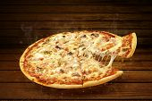 Pizza On Wooden Table. Flying Hot Pizza Seafood Closeup With Mozzarella Cheese And  Steam Smoke poster