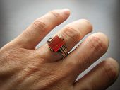 Yemeni Red Akik Agate Stone. Male Hand With Ring On Ring Finger With Dark Background. Yemen Ring. Me poster