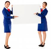 Air hostesses holding a banner - isolated over a white background