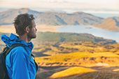 Hiker man on New Zealand trek hike tramping on outdoor trail mountain landscape. Young caucasian tra poster