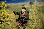 Hunter Hold Rifle. Man Wear Camouflage Clothes Nature Background. Hunting Permit. Hunting Equipment  poster