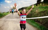 Small Girl Runner Crossing Finish Line In A Race Competition In Nature. poster