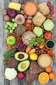 Health food for a high fibre diet with fruit, vegetables, legumes, nuts, whole grain bread rolls, se poster