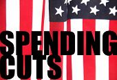 American flag with spending cuts words