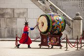 Striking The Ceremonial Drum