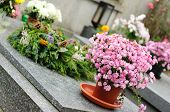 pic of urn funeral  - Funeral flowers placed on the grave at All souls holiday - JPG