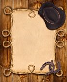 Cowboy Background With Rope Frame And Western Clothes