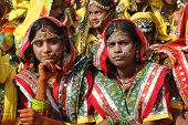 Rajasthani girls are preparing to perfomance at annual camel fair holiday in Pushkar,India