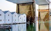 White Boat Houses Under Large Bridge. Tacoma, Downtown.