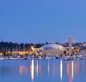 Tacoma Dome With Boats And Marina. City Downtown At Night.