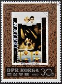 A stamp printed in North Korea shows Auguste and Jacques Piccard one stamp from series The Conqueror