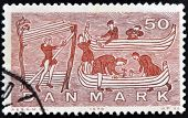 DENMARK - CIRCA 1970: A stamp printed in Denmark shows construction of a Viking ship circa 1970
