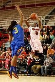 JAMAICA, NY-JAN 2: St. John's Red Storm guard Aliyyah Handford (3) shoots over Delaware Blue Hens gu