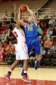 JAMAICA, NY-JAN 2: Delaware Blue Hens guard Lauren Carra (22) shoots over St. John's Red Storm guard