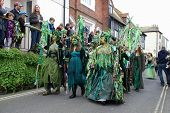 HASTINGS, ENGLAND - MAY 7: Costumed people parade through the Old Town at the Jack In The Green fest