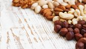 stock photo of mixed nut  - Mixed nuts on a old wooden background  - JPG