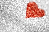 stock photo of heart  - An abstract silver glitter and heart background