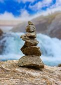 Stigfossen Waterfall And Stones Stack - Norway