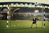 Little boy plays football