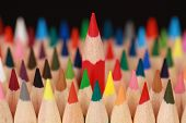 Concept Red Pencil Standing Out From The Crowd