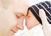 Happy Father With Newborn Son